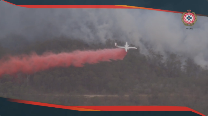 Large air tanker water drop over Kooralbyn Bushfire